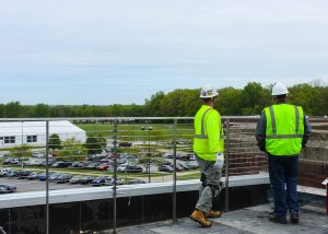 Roofers Wearing Yellow Safety Vests on Commercial Job Site
