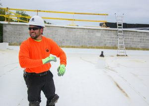 Smiling Roofer on Commercial Job Site
