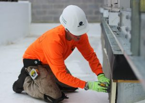 Roofer Installing Insulation on Commercial Roofing Job