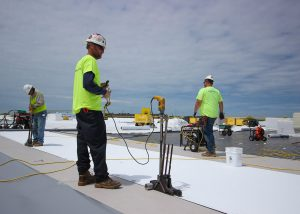 Roofers Working on Commercial Job Site