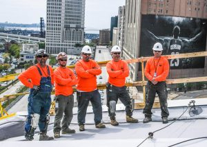 Warren Roofing Commercial Roofing Installers on Roof in Cleveland
