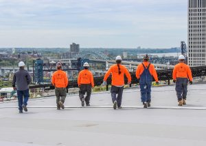 Warren Roofing Crew Walking on Roof in Downtown Cleveland