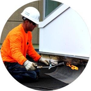 Man Repairing Roof With Torch