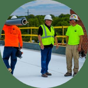 Men Working Talking On Roof